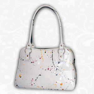 Umelecká ručne maľovaná kožená kabelka.Kožená kabelka je umeleckým dielom vďaka ručnému frkaniu farby na povrch kože